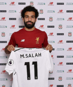 Liverpool have completed the 39m euro (£34m) signing of winger Mohamed Salah